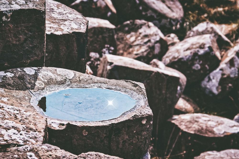 blue water on brown rock