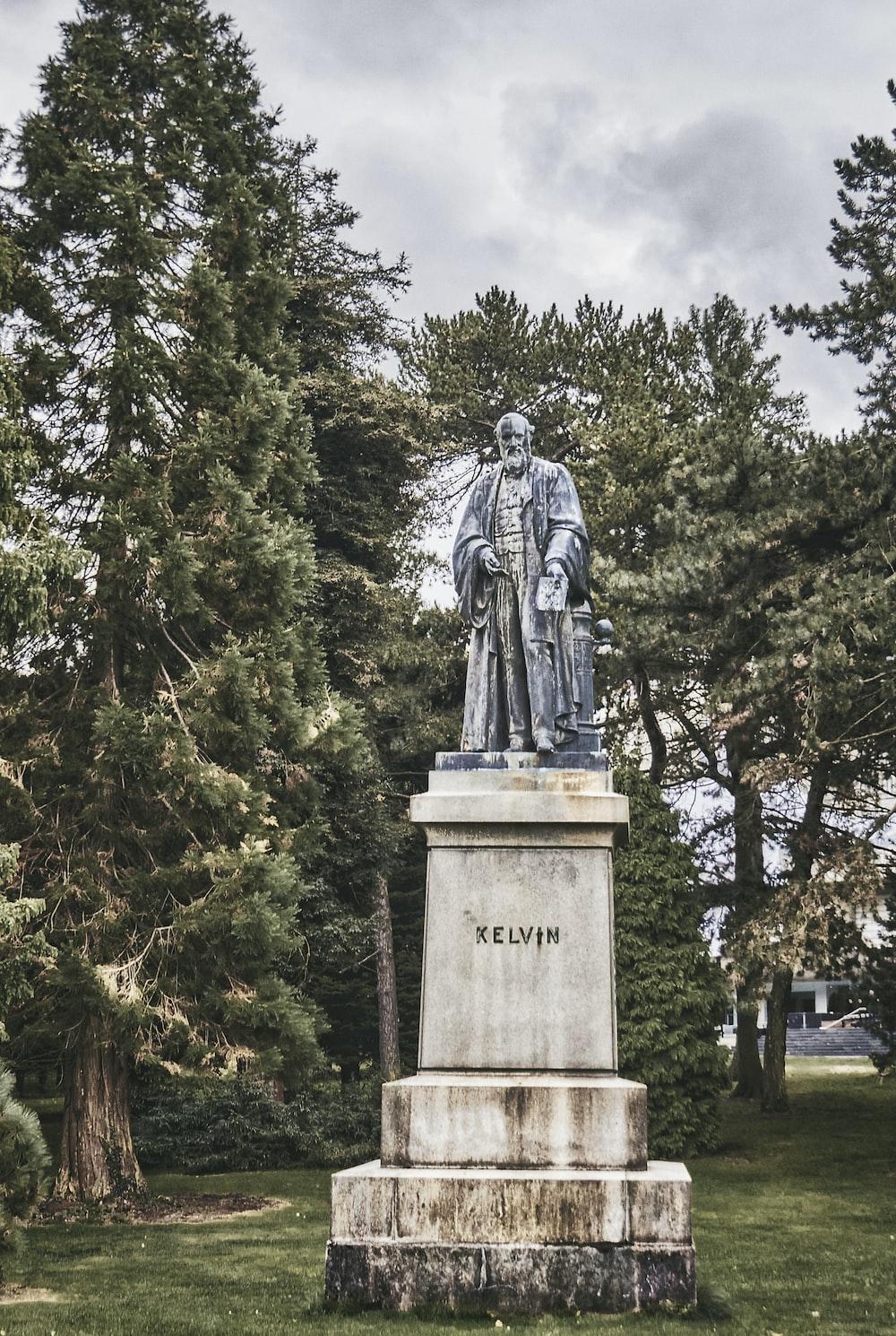 statue of man in black coat