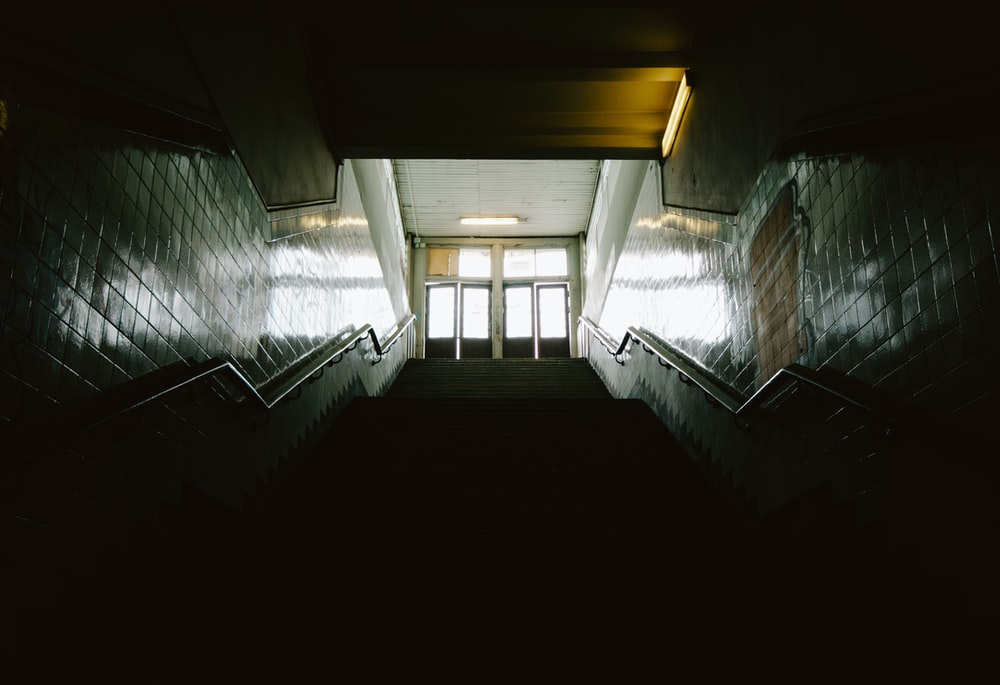 long angle photography of dark staircase