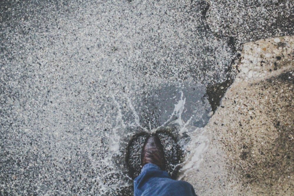 person stepping on wet ground