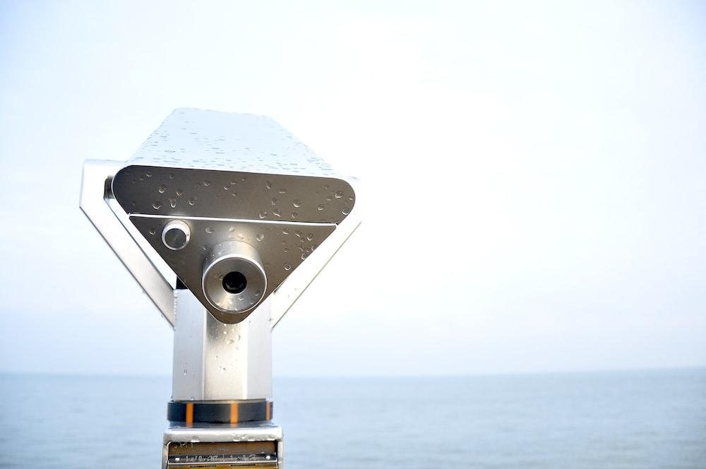 silver telescope with rain drops
