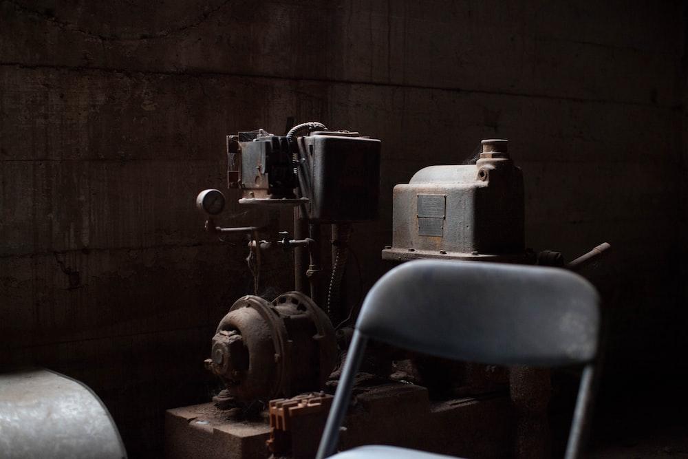 AC motor-powered machine behind chair