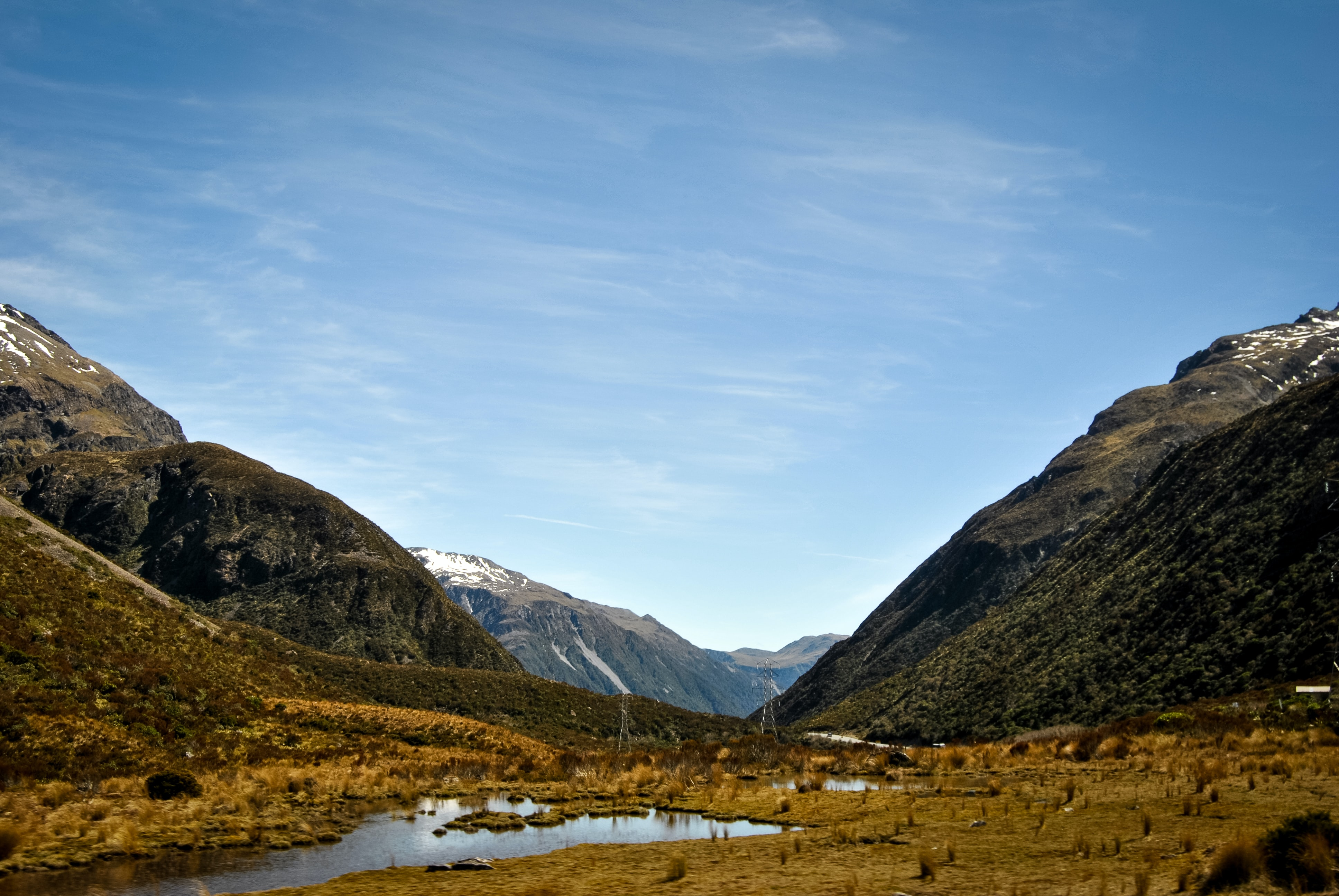 Golden and brown wetlands in a mountain valley in New Zealand on a cold morning