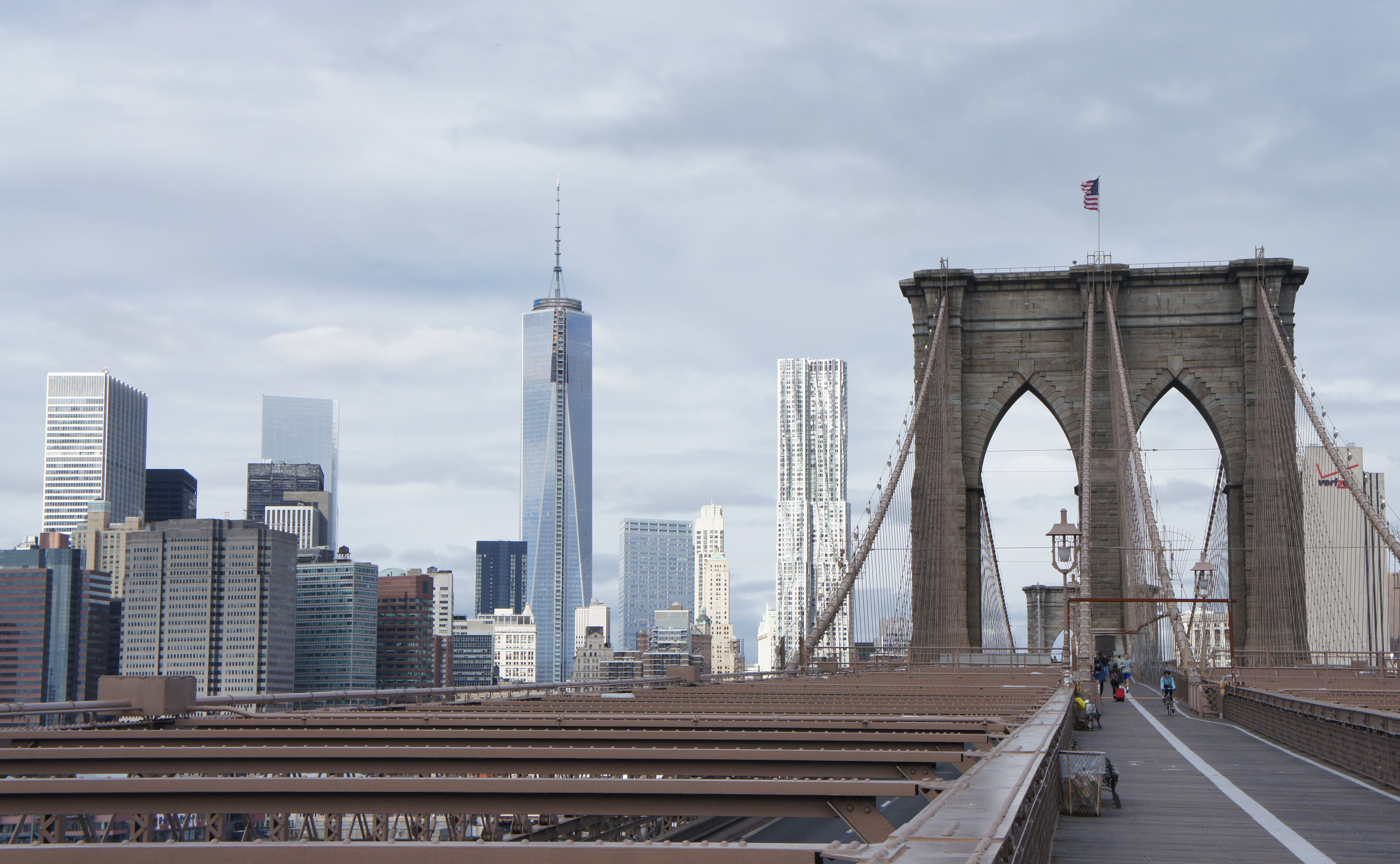 View of the Freedom Tower from the walkway on the Brooklyn Bridge in New York City
