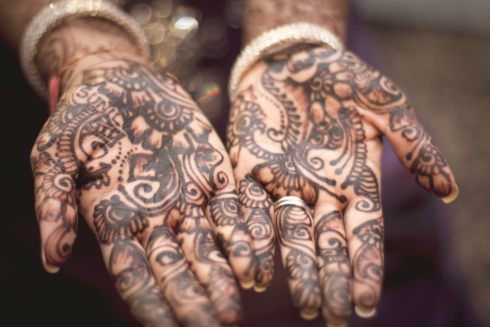 person showing hand tattoos