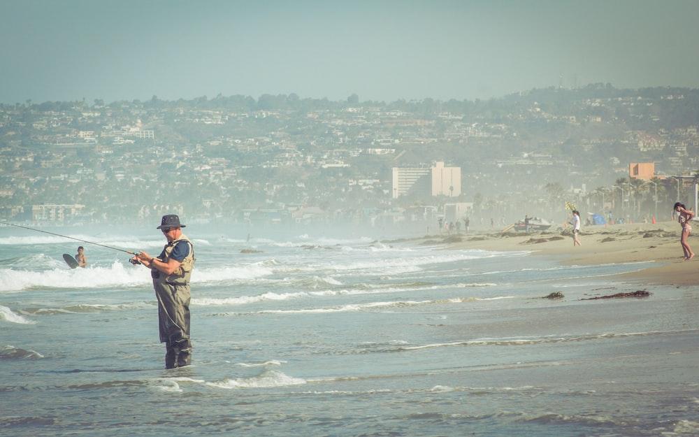 man standing on seashire