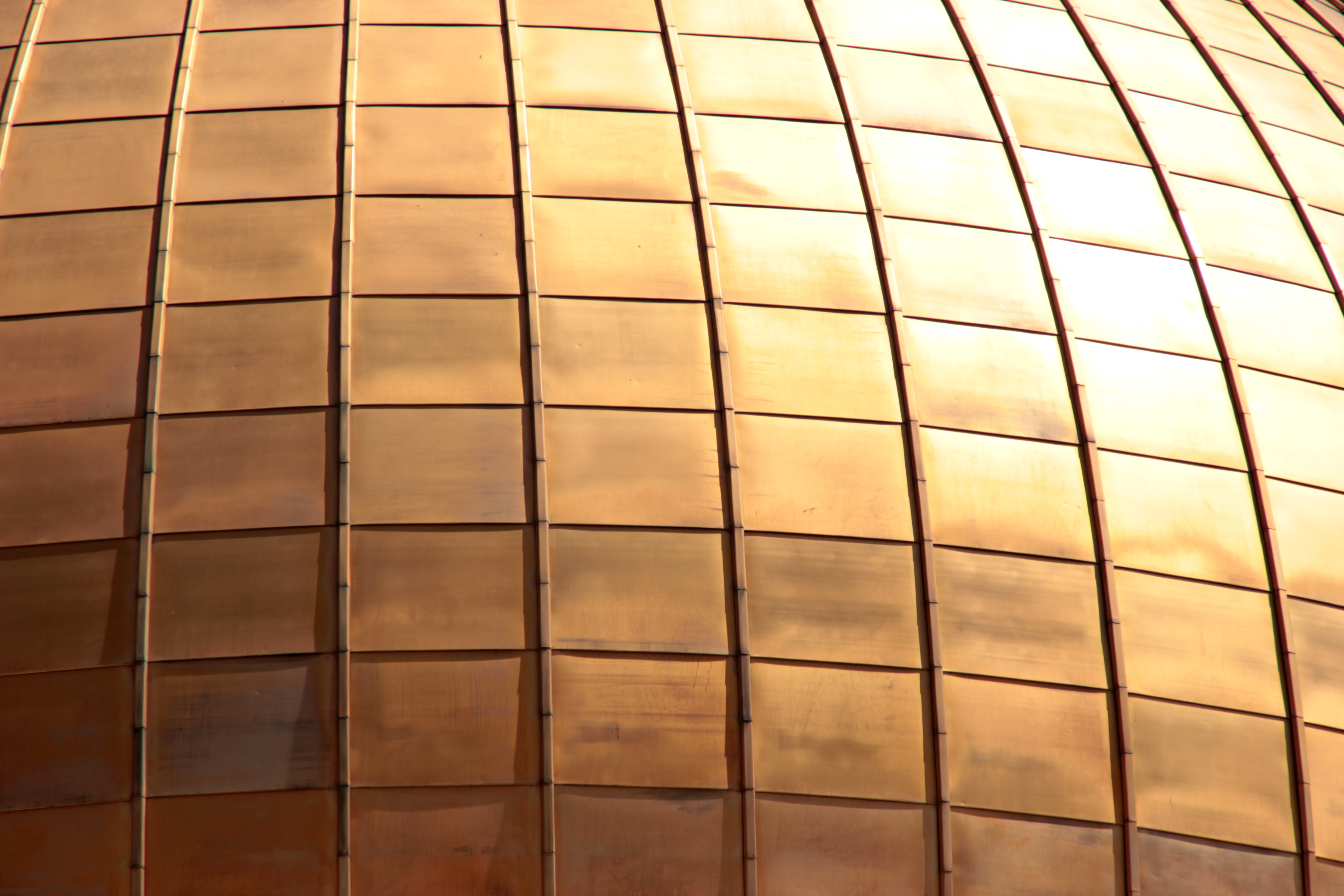 closeup photo of brass-colored wall