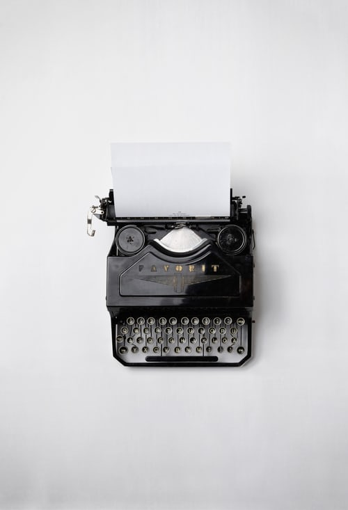 A picture of a typewriter with paper in it