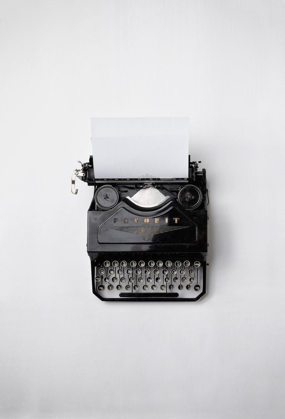 black Fayorit typewriter with printer paper