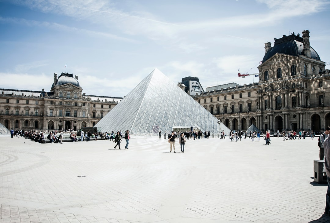 Louvre courtyard with visitors