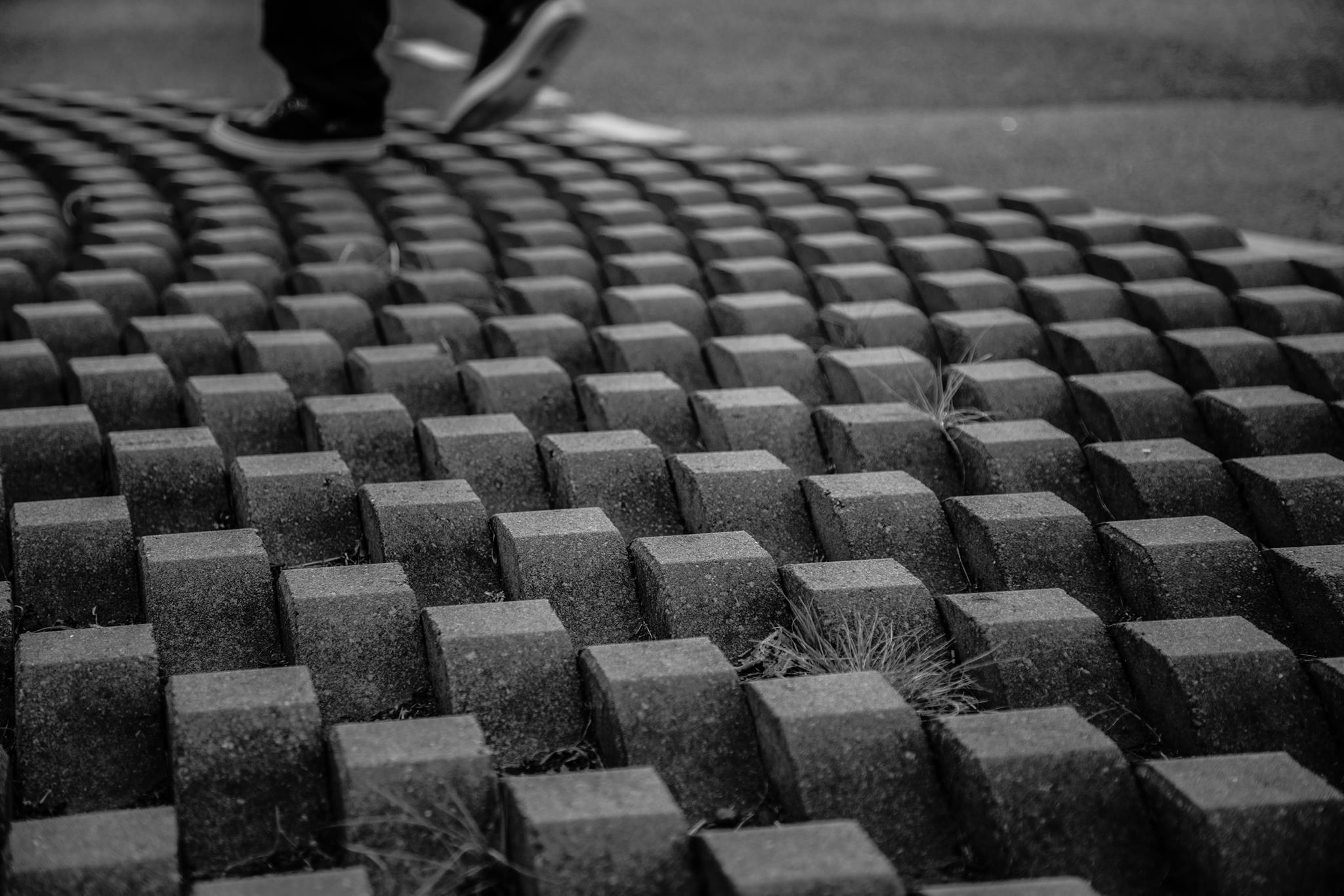 person standing on concrete block