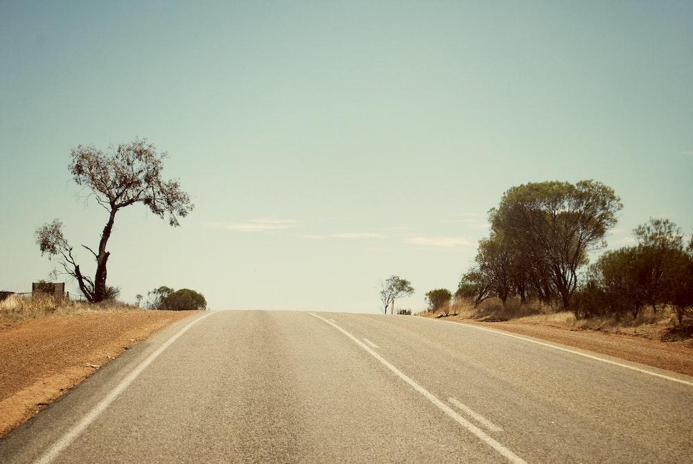 gray empty road under gray sky