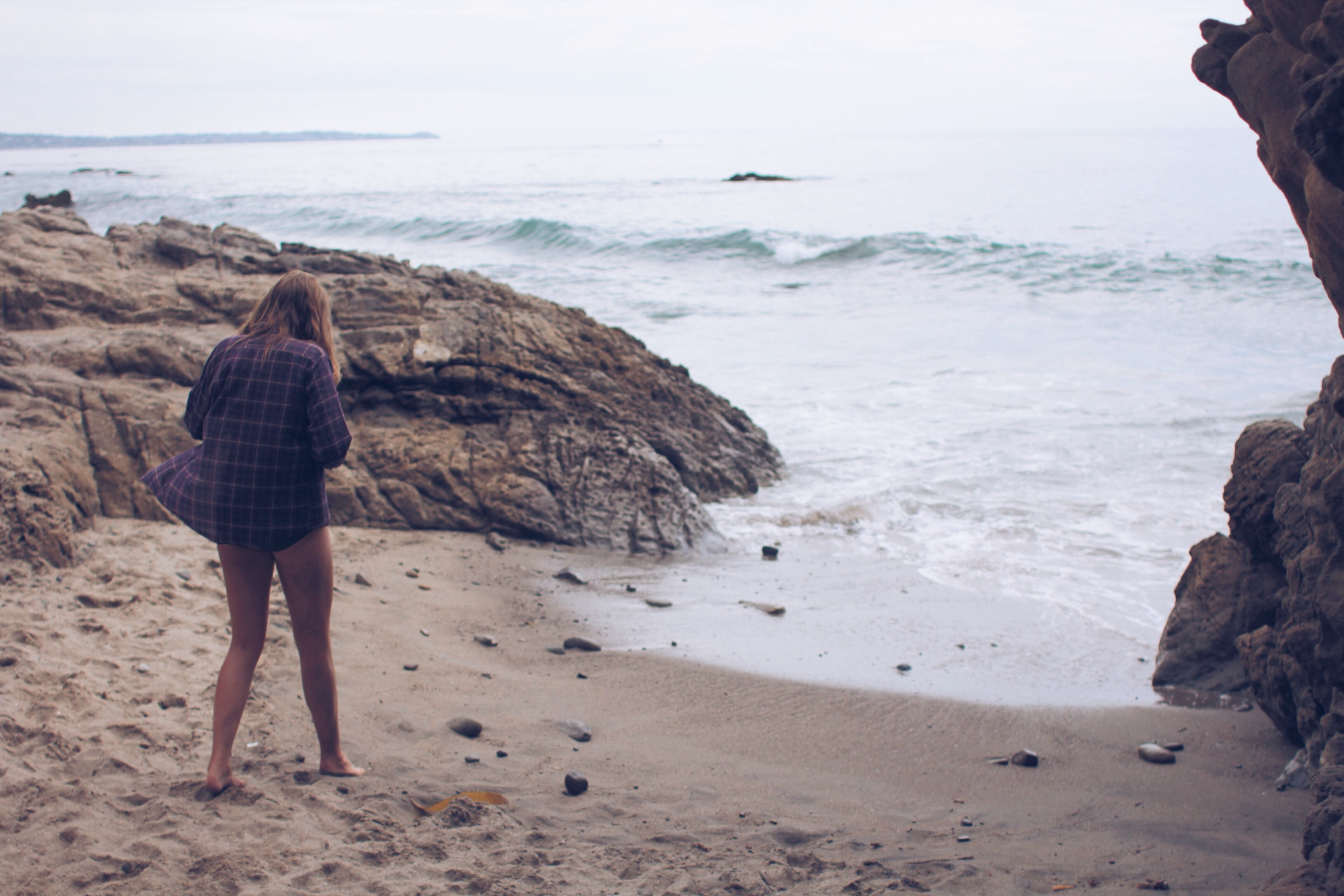 Woman on vacation steps out of the cove to relax in the beach shores