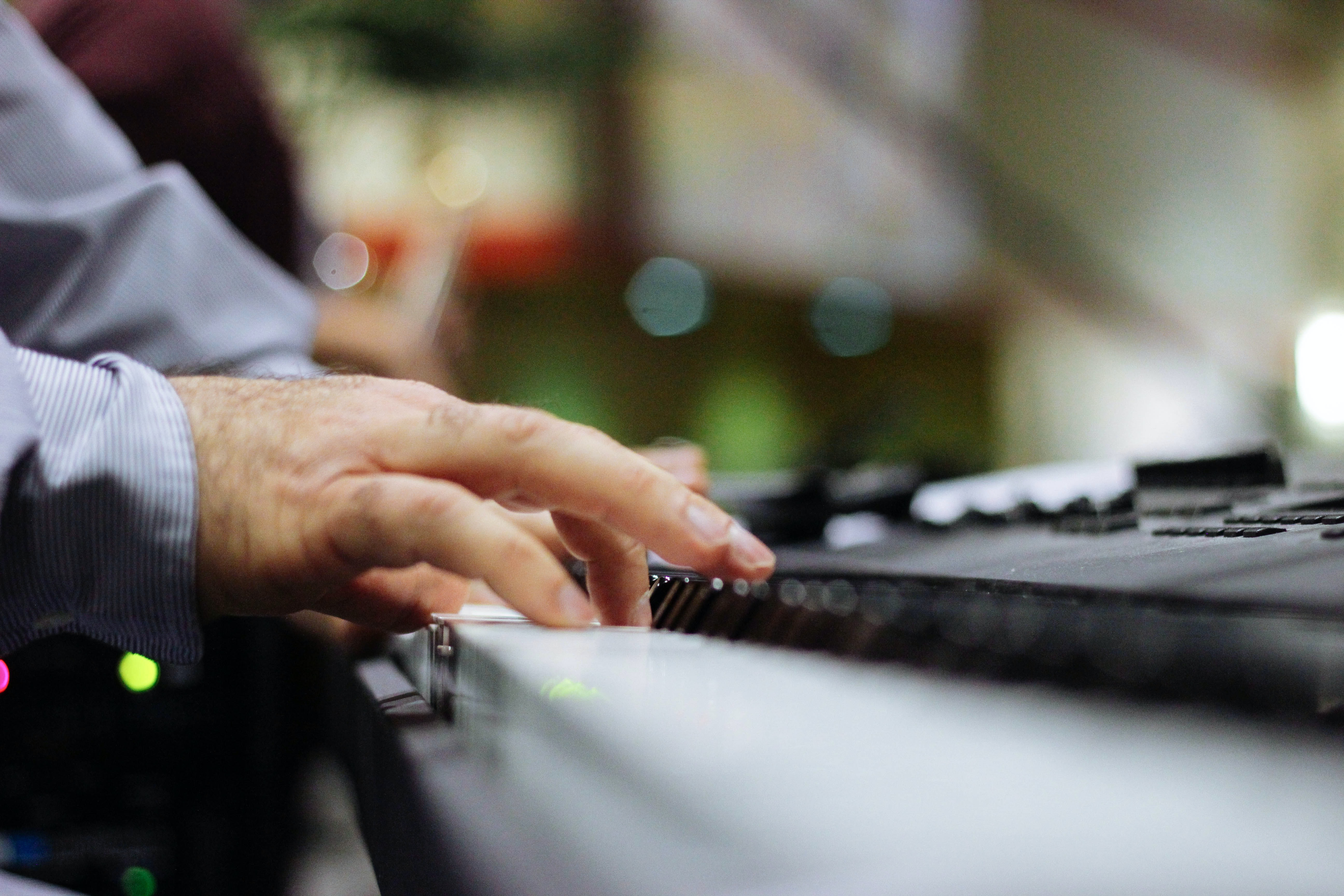 selective focus of person playing piano
