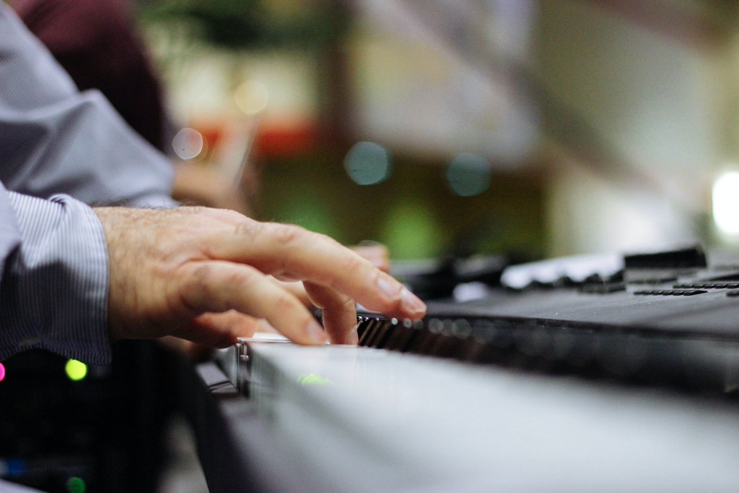Man playing the Roland FP-30 Digital Piano
