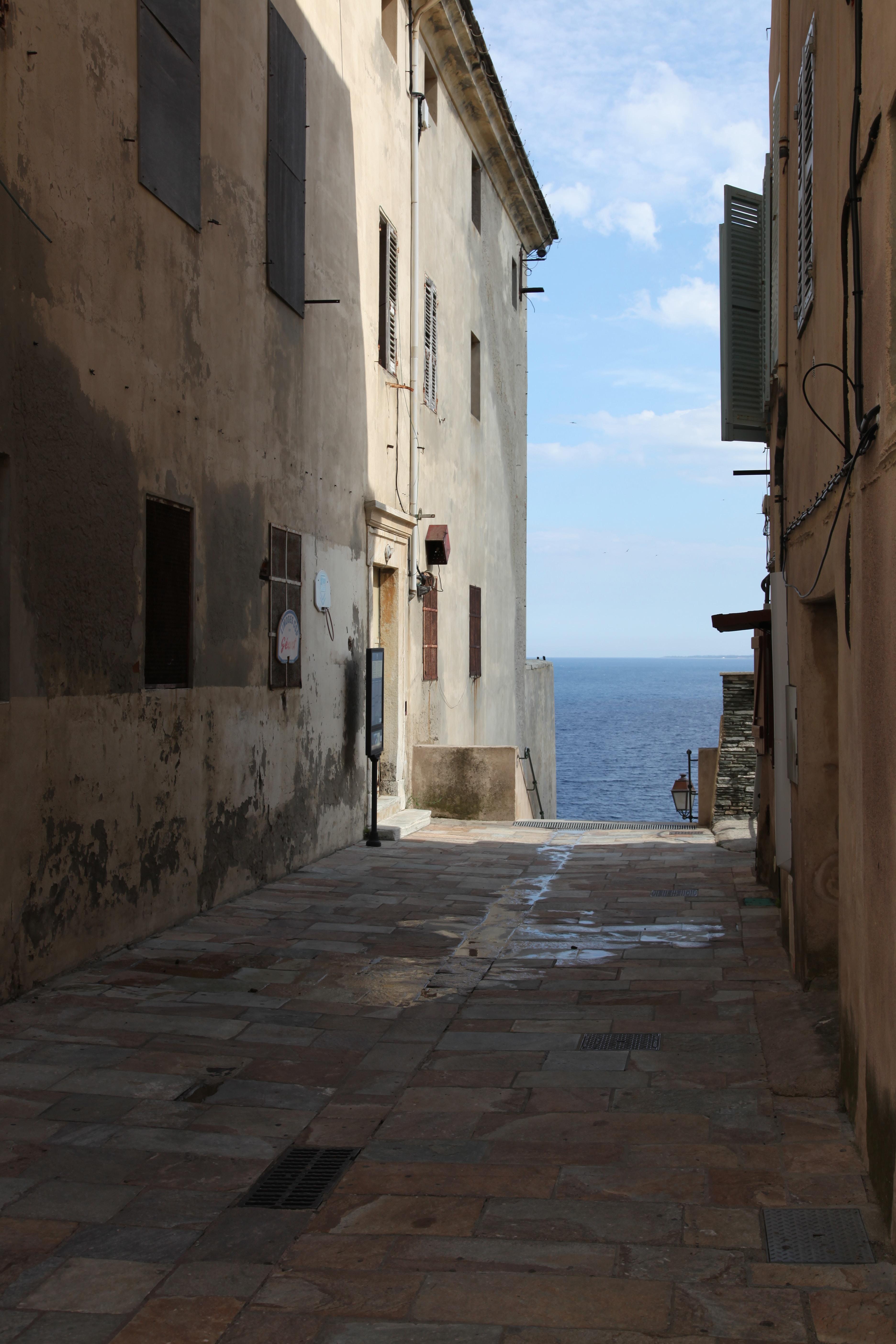 empty street near body of water