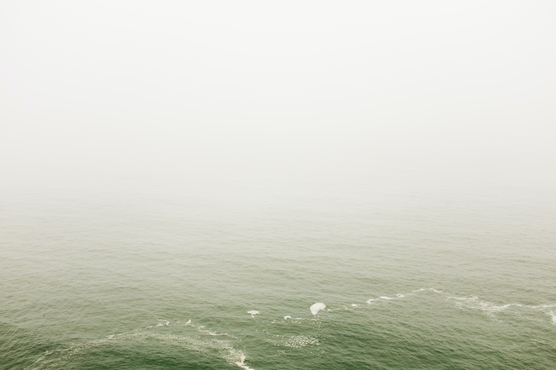 Hazy fog over green sea waters