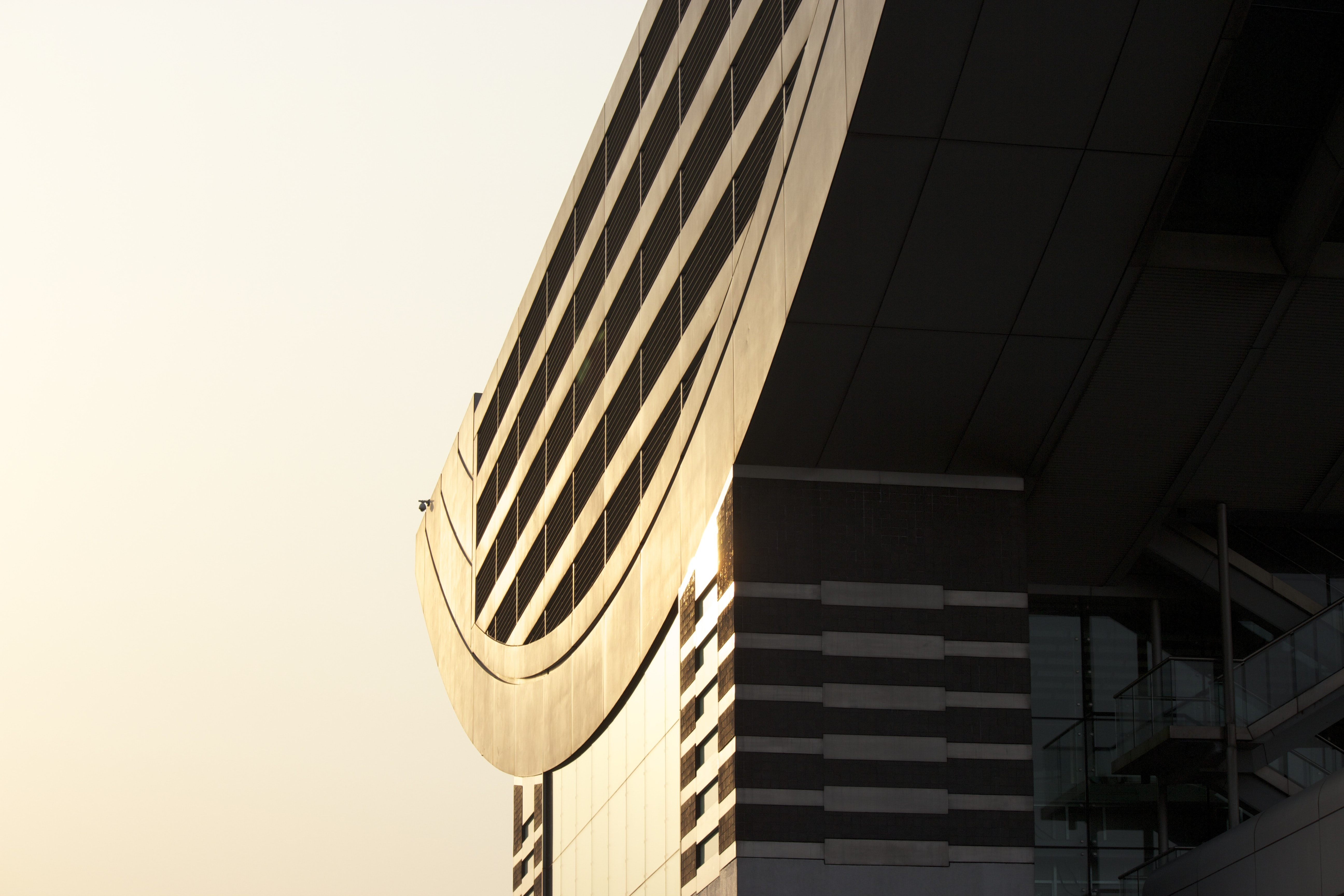 The facade and roof of a modern building in bright sunlight