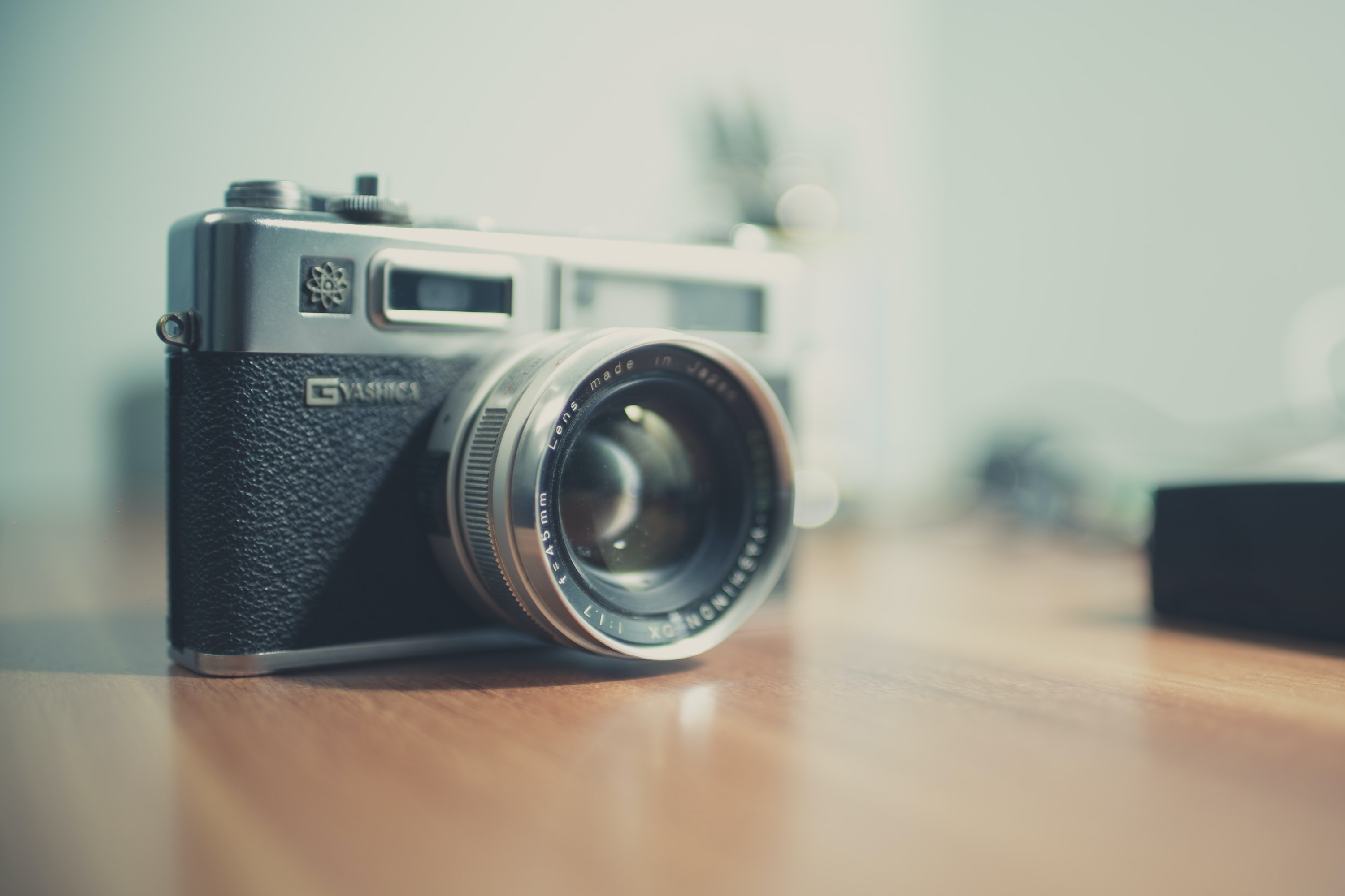 Close-up of a Yashica camera on a wooden surface