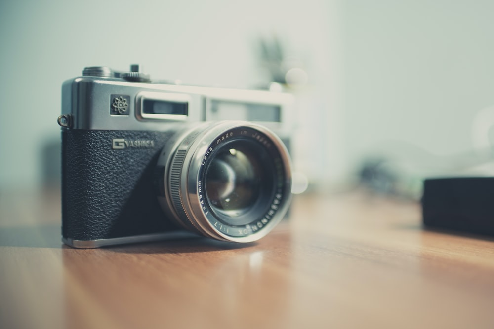 black and gray point-and-shoot camera