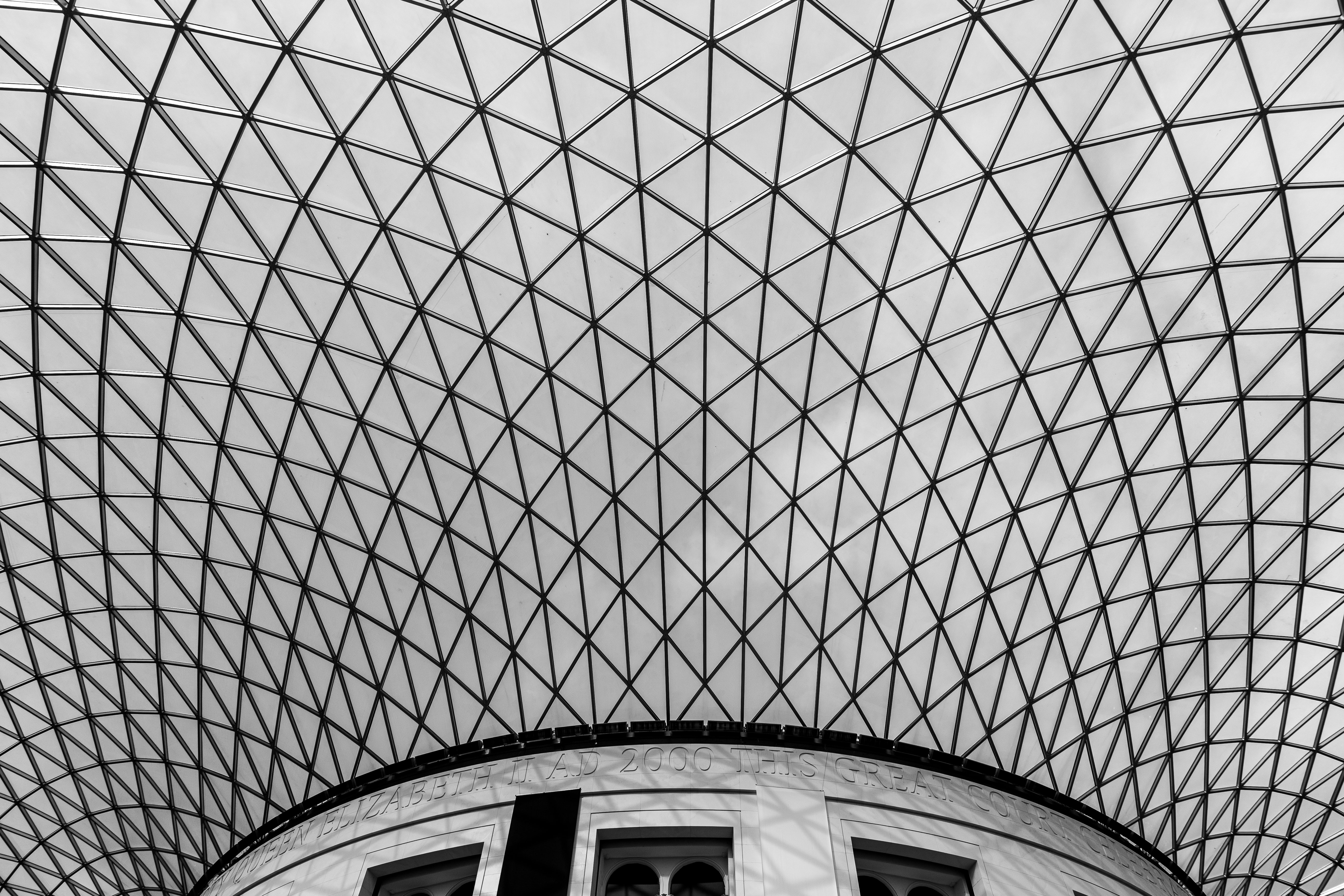 A white latticework ceiling in the British Museum