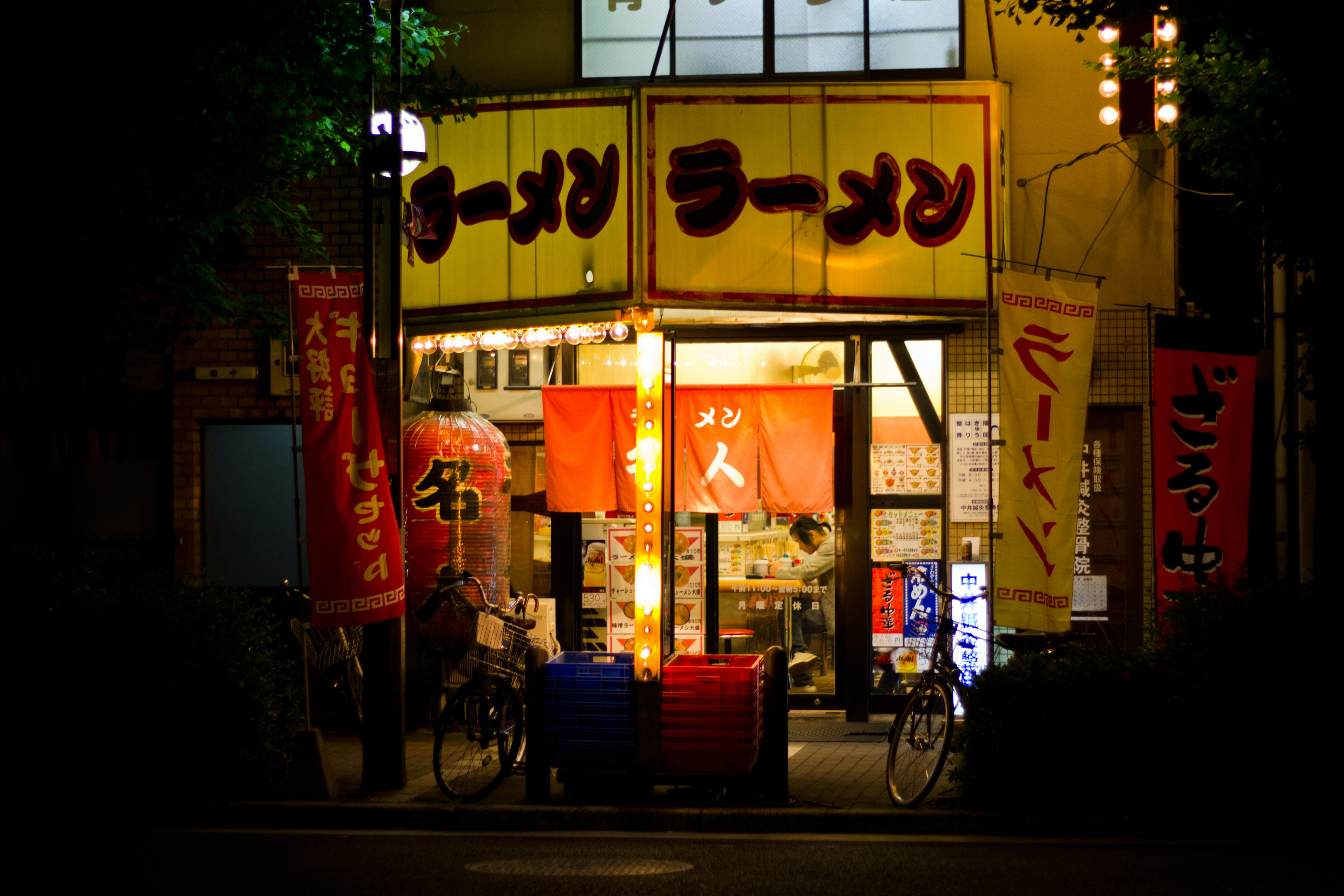 Storefront of an Asian restaurant at a city market at night