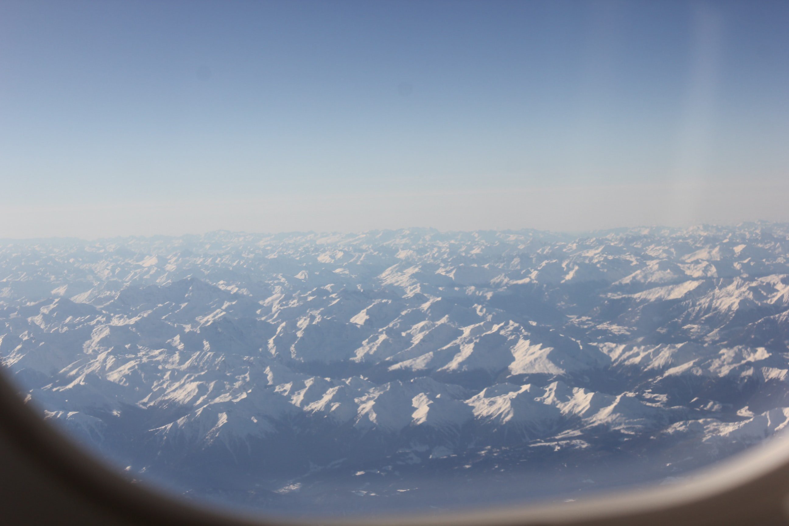 View from an airplane window on a vast mountainous area