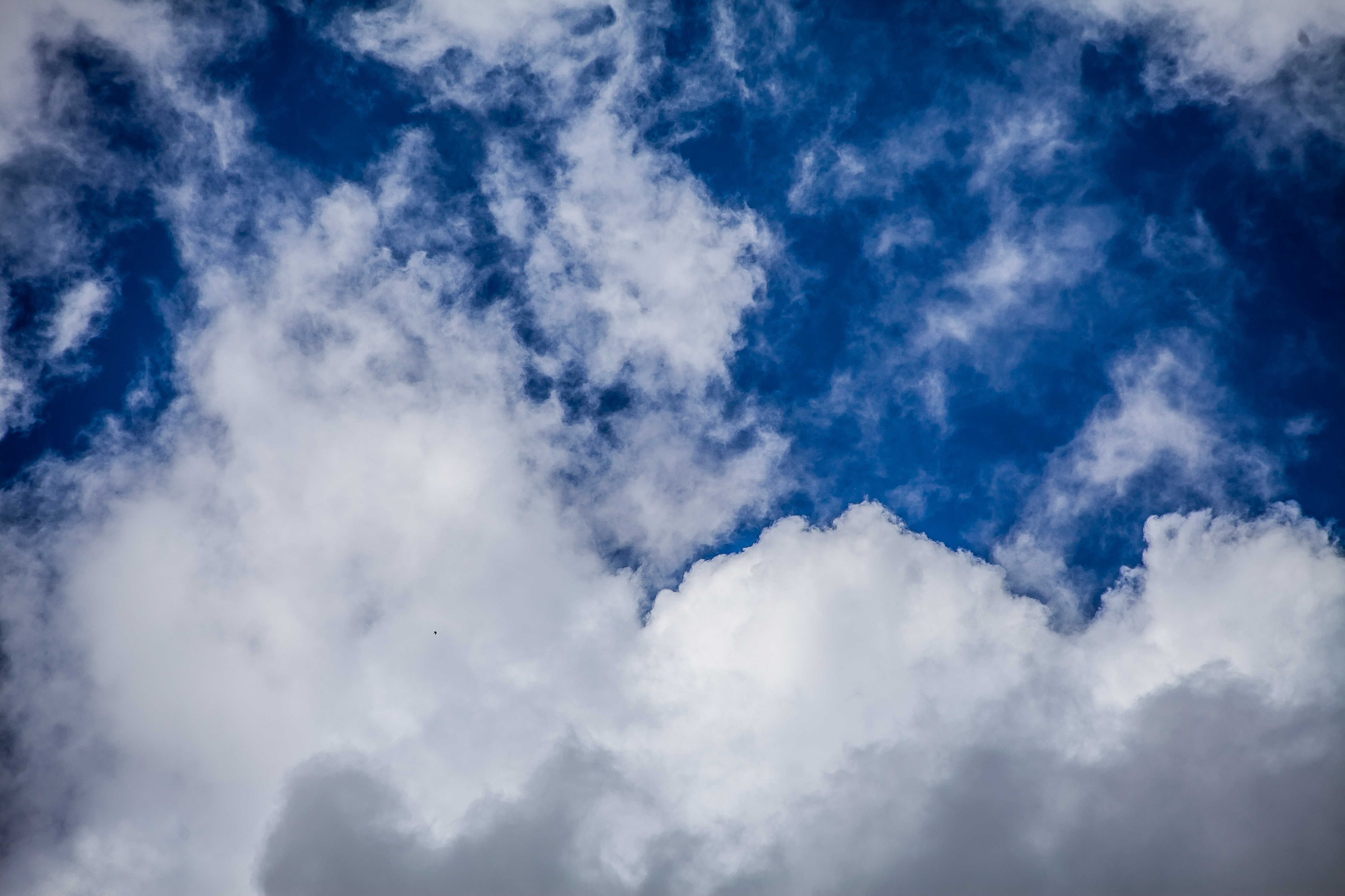 Cloud formations against a sapphire blue sky