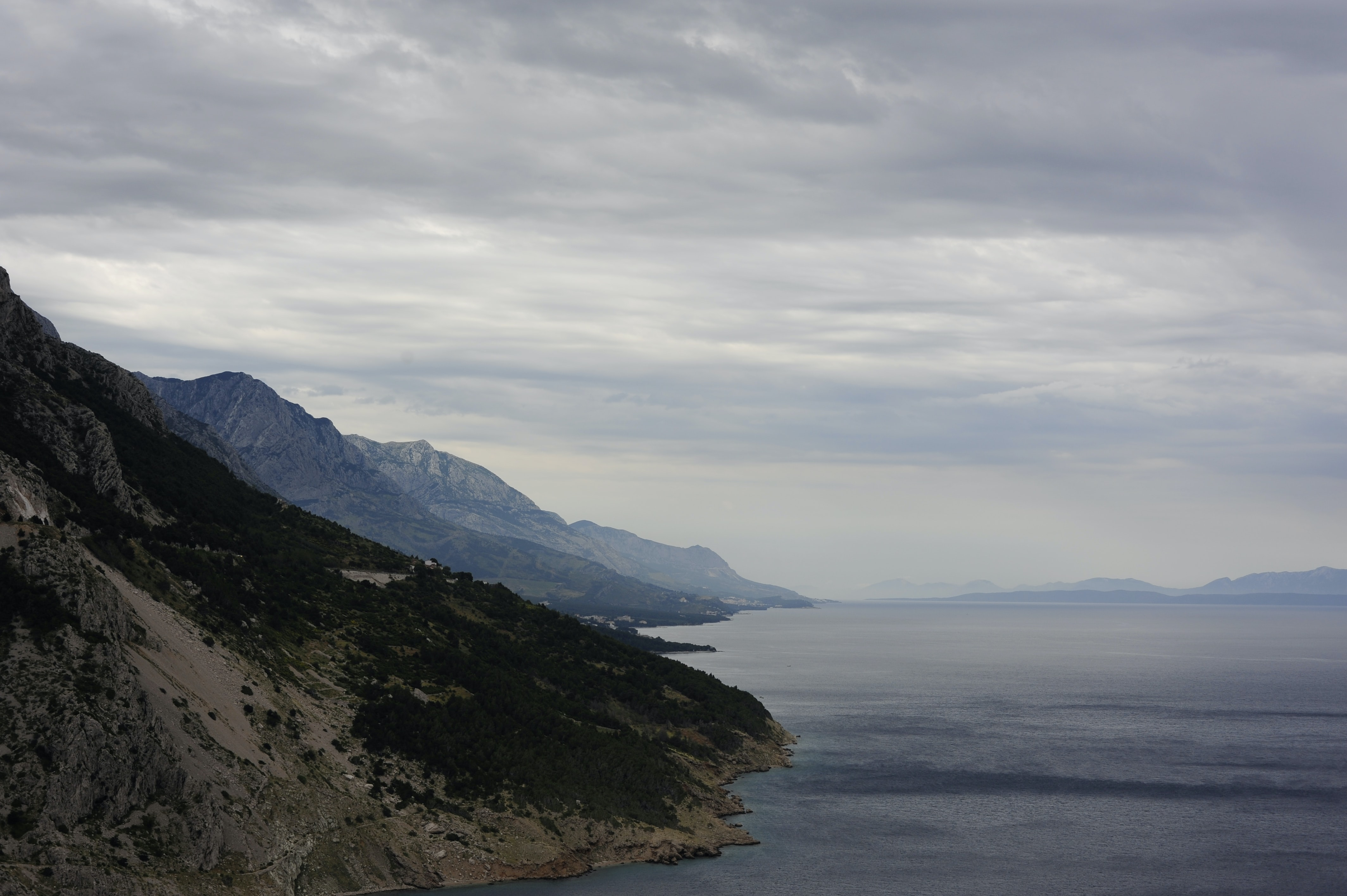 An empty mountainous coast under thick clouds