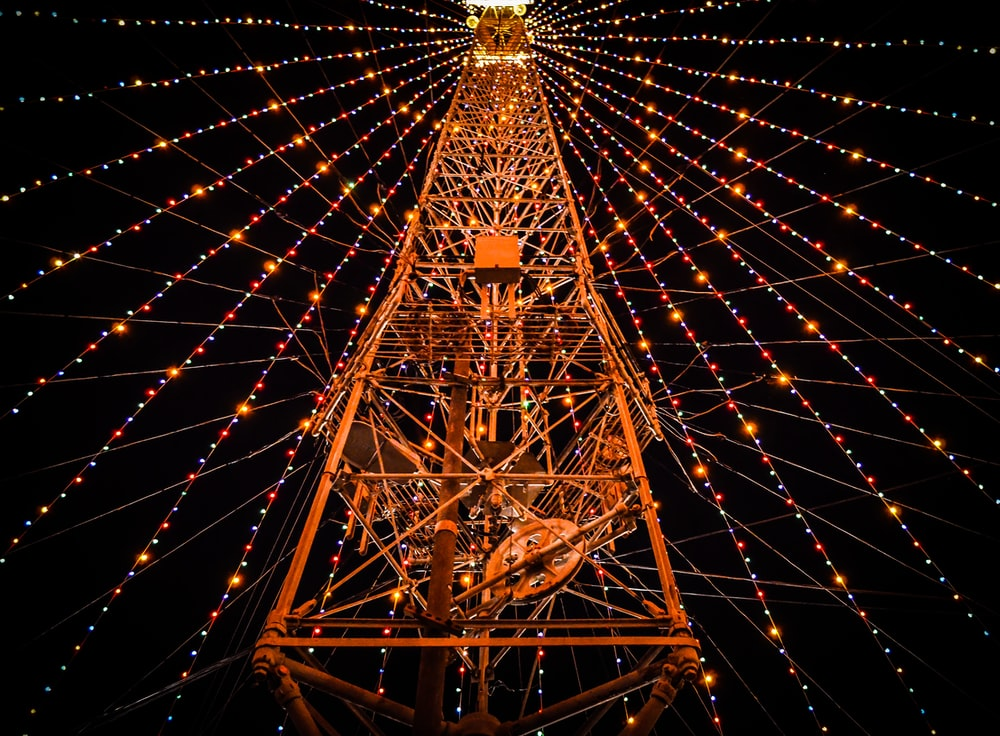 photo of tower with string lights