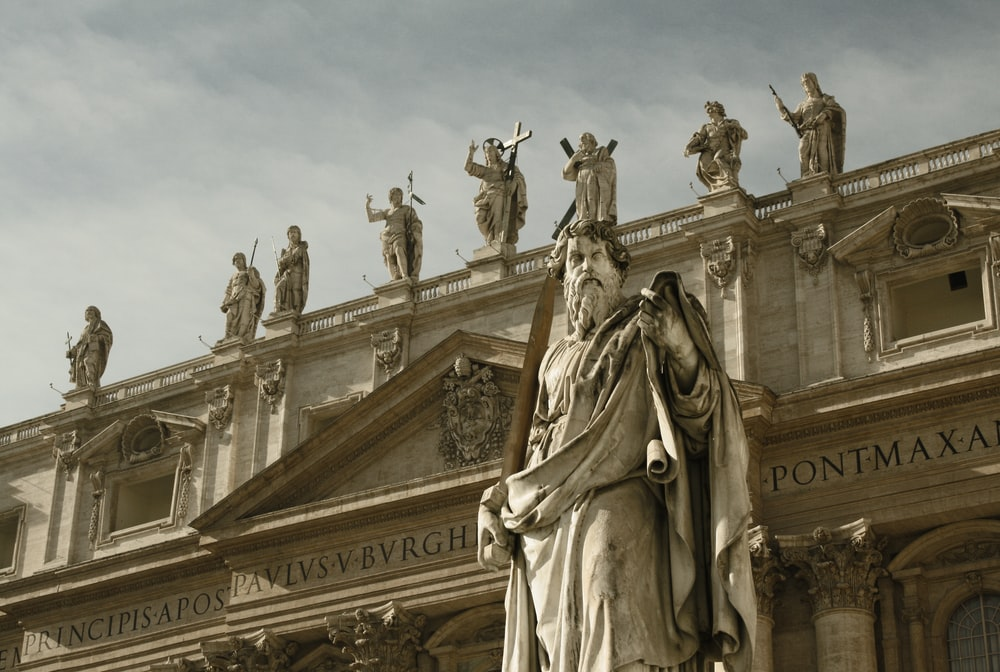 Statue of Saint Paul in front of Saint Peter's Basilica in Vatican City. Photo Credit to Nils on Unsplash.