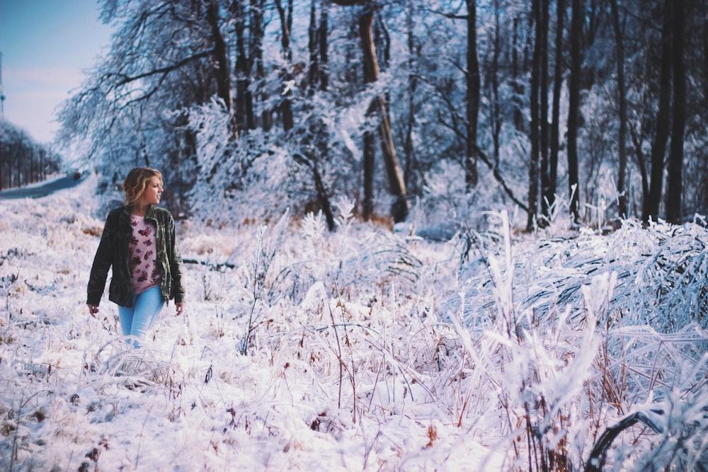 woman walking around forest