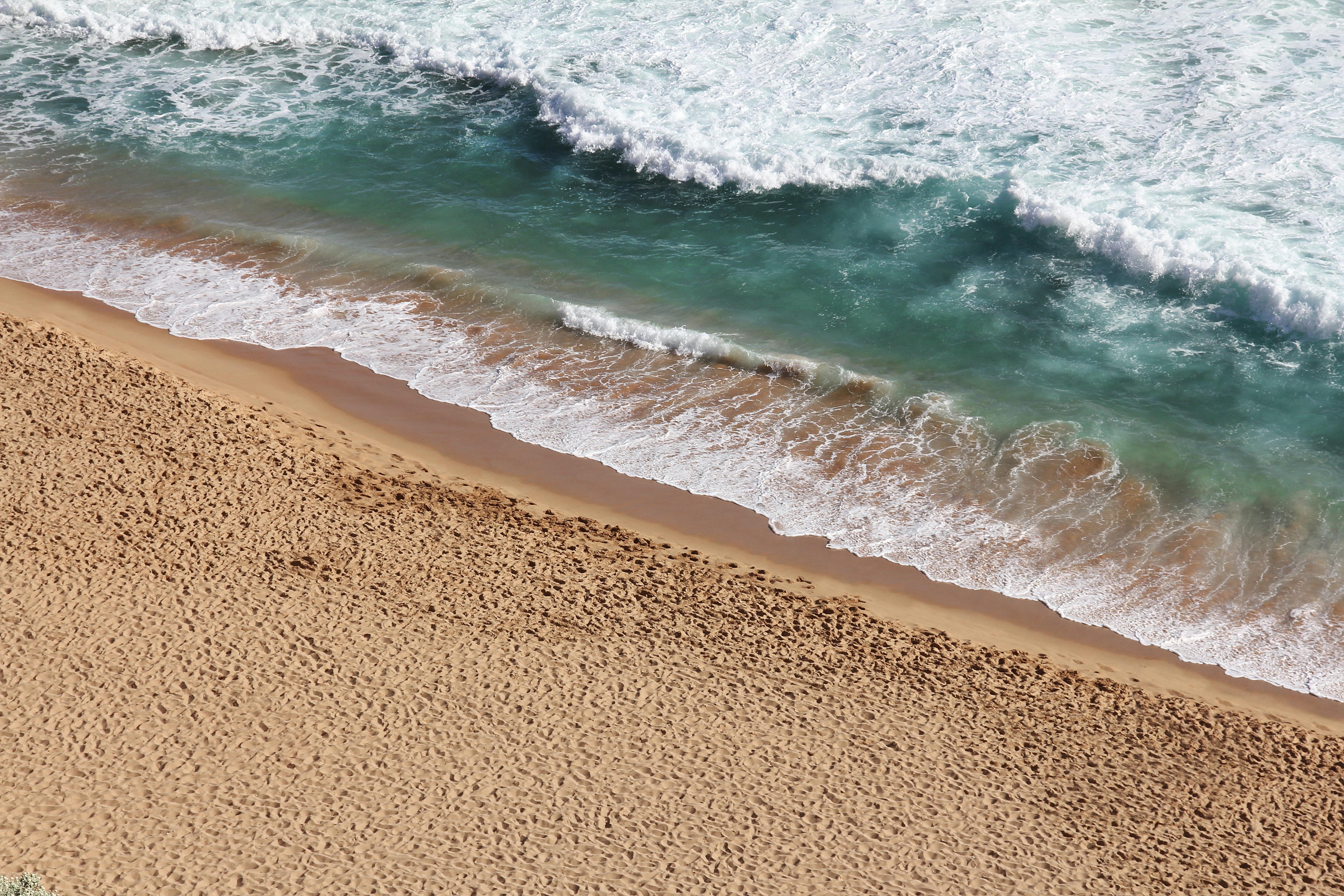 Ocean washing on the sand beach
