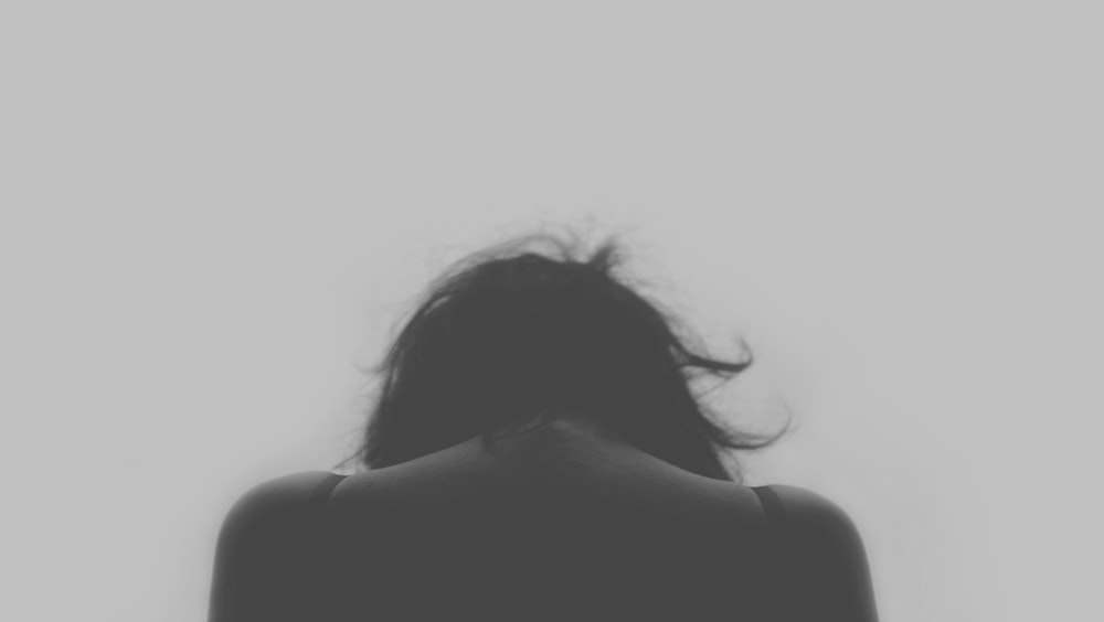 grayscale photo of person's back