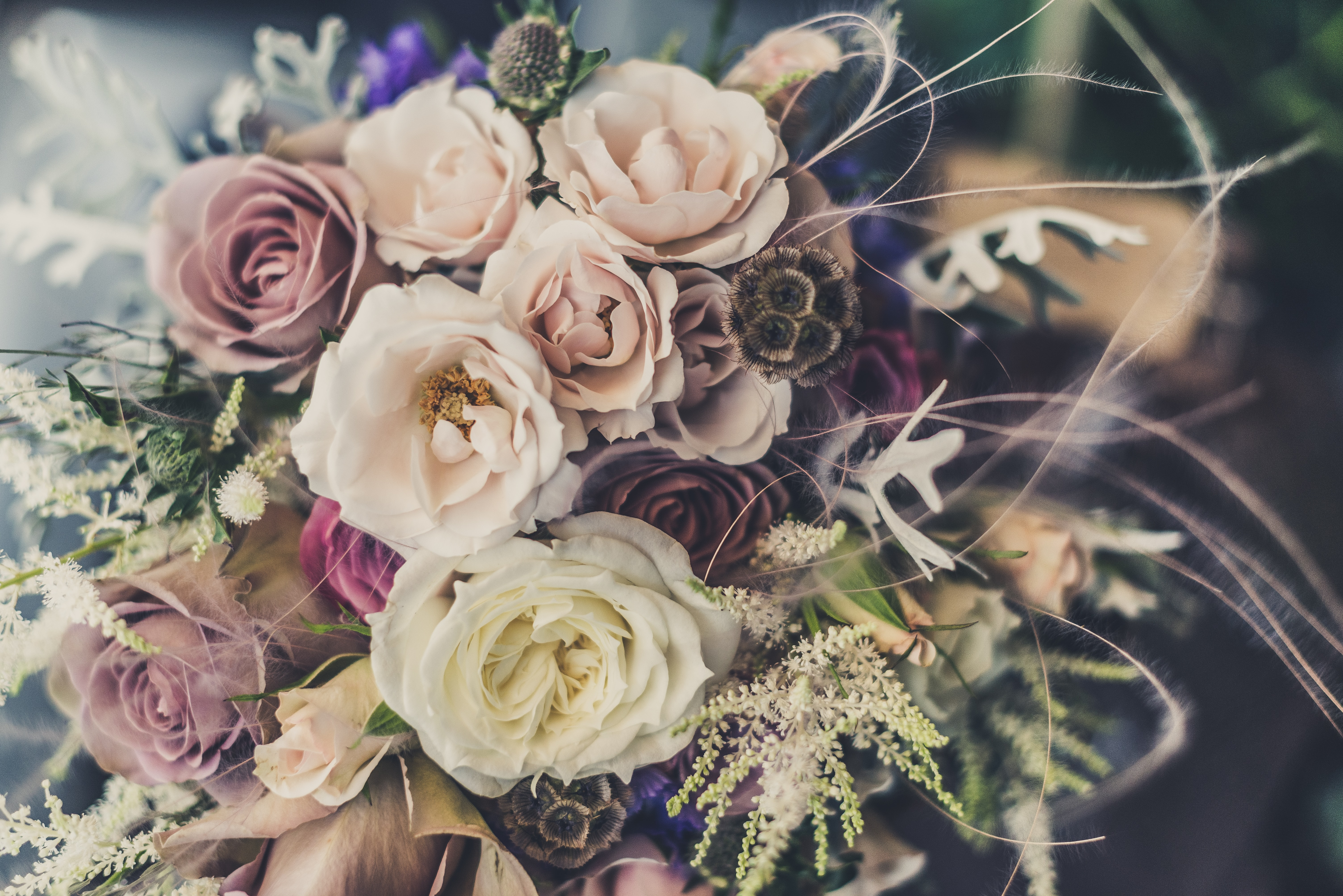 A large bouquet of roses in pastel colors