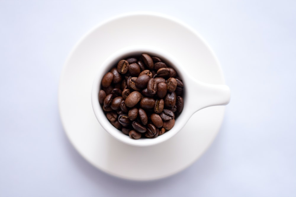 coffee bean filled coffee cup with matching saucer