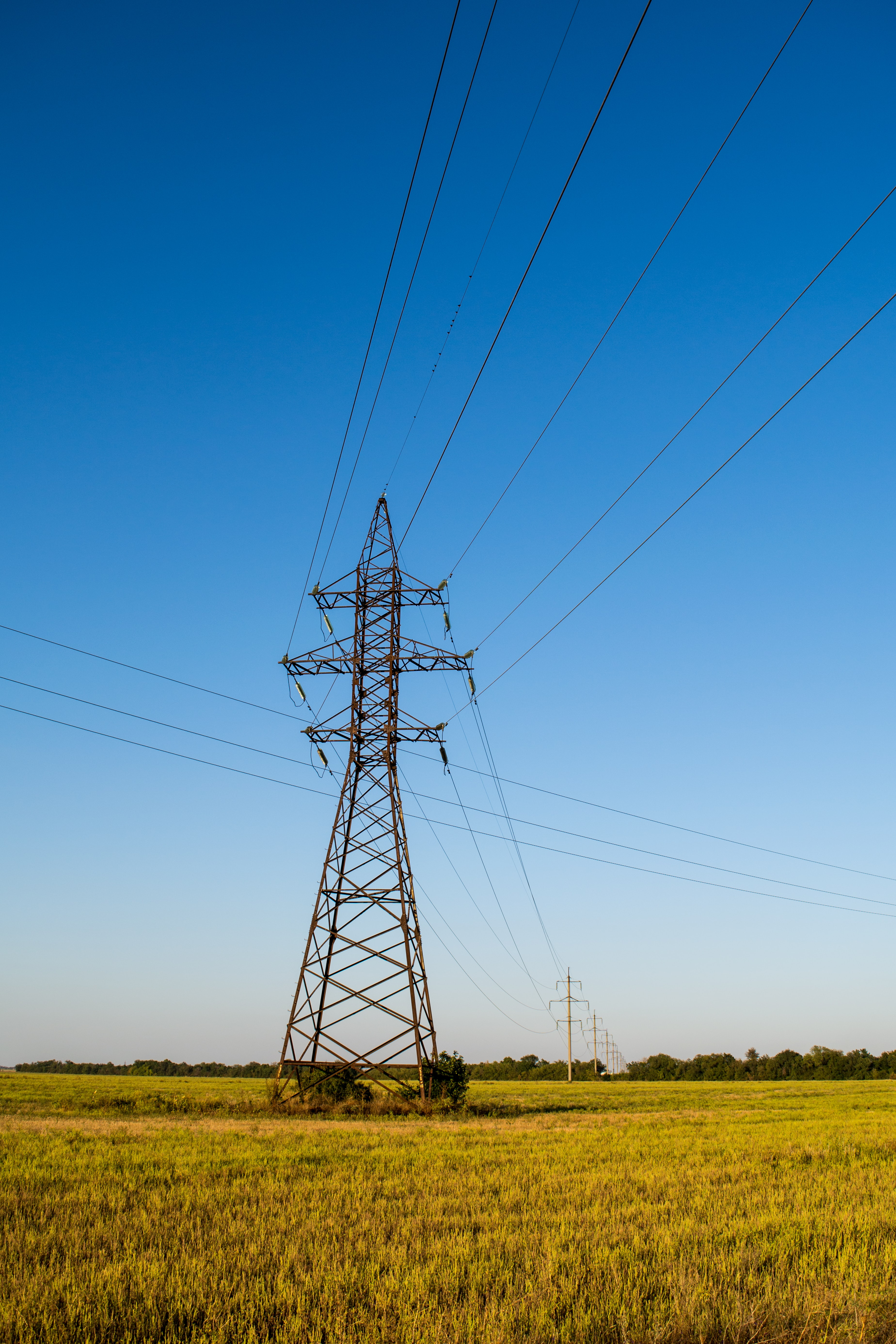 landscape photography of transmission tower