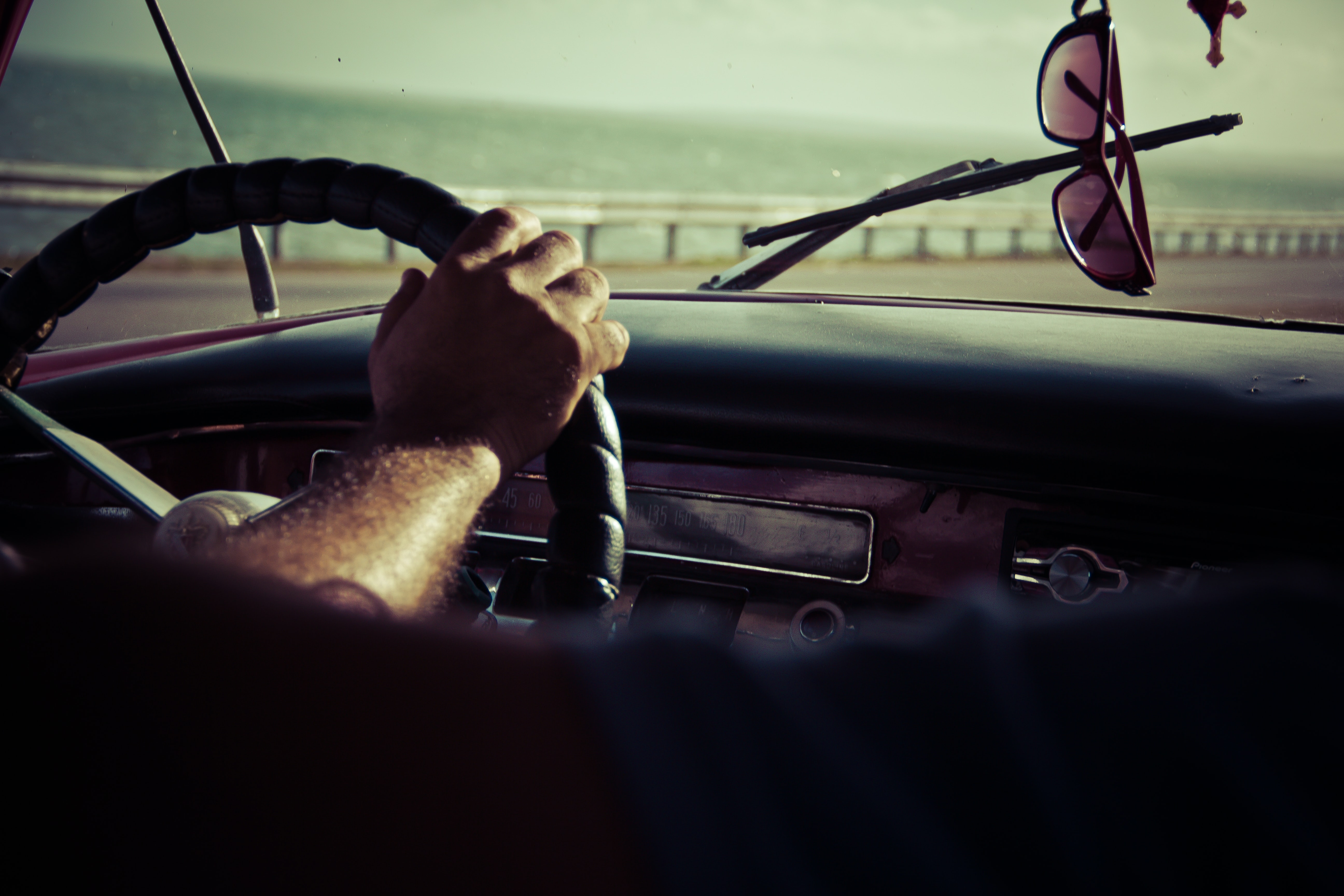 person holding steering wheel