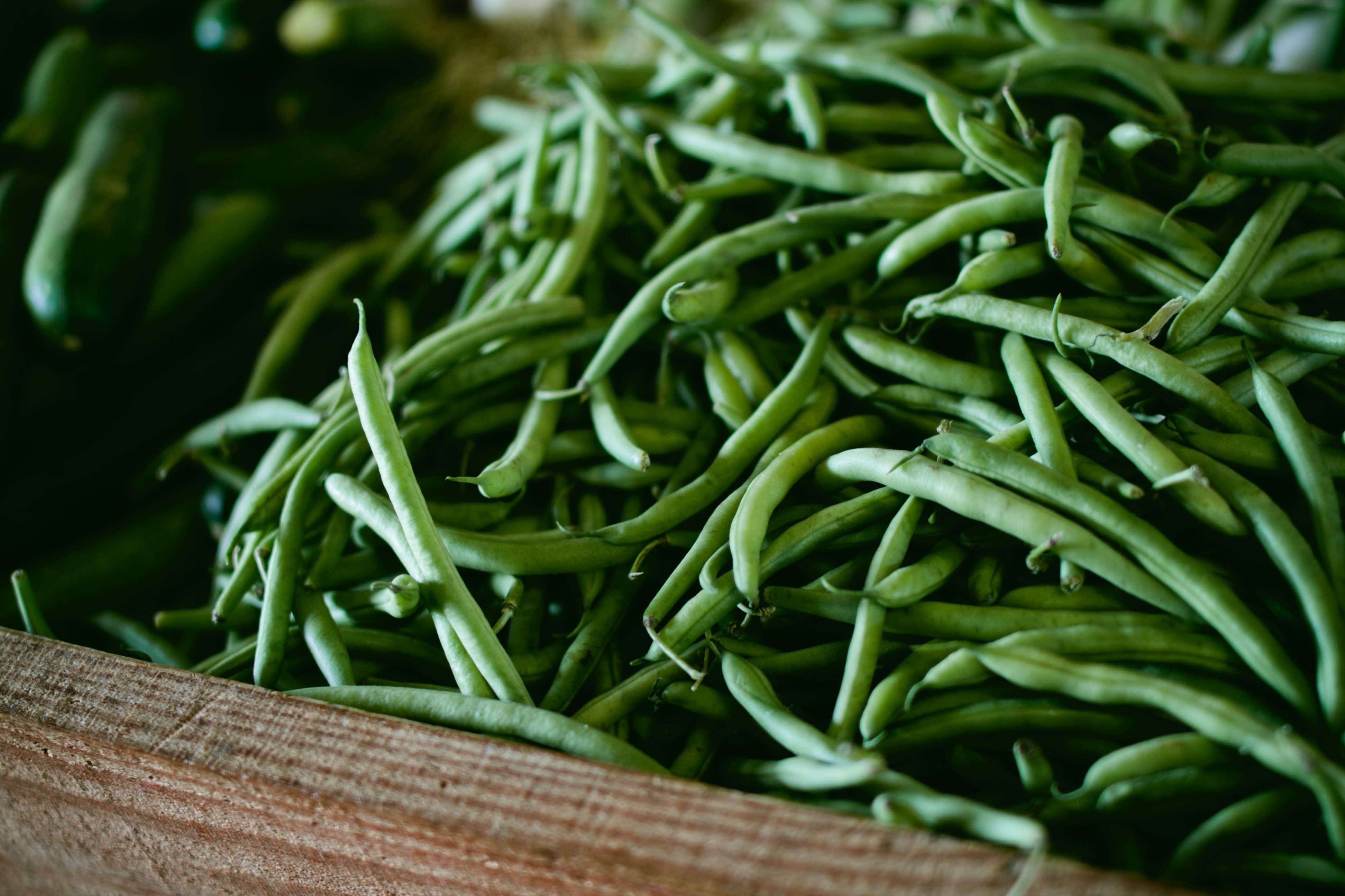 Basket of fresh green beans at a vegetable market
