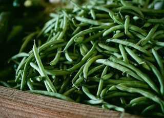 focus photography of green string beans