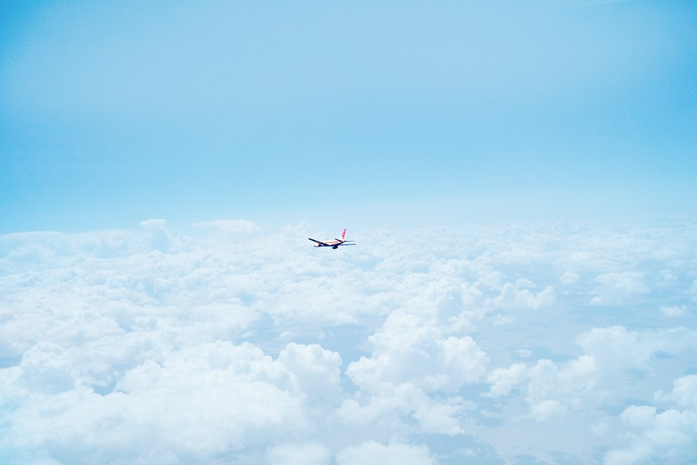 flying airplane above clouds
