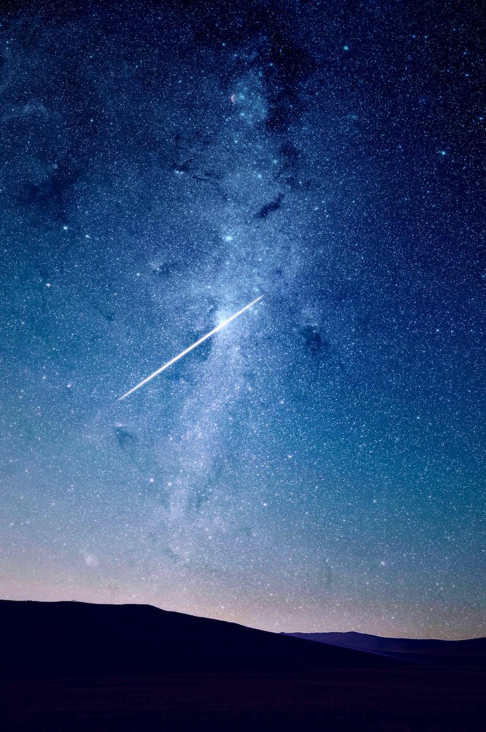 shooting star under blue sky