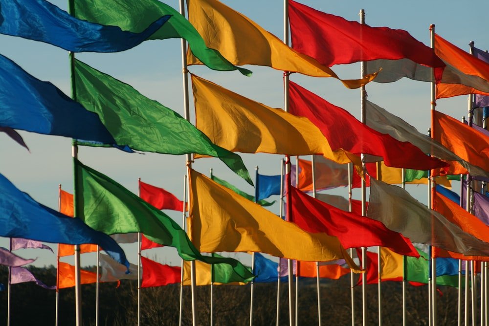 assorted-colored flags waving in the wind