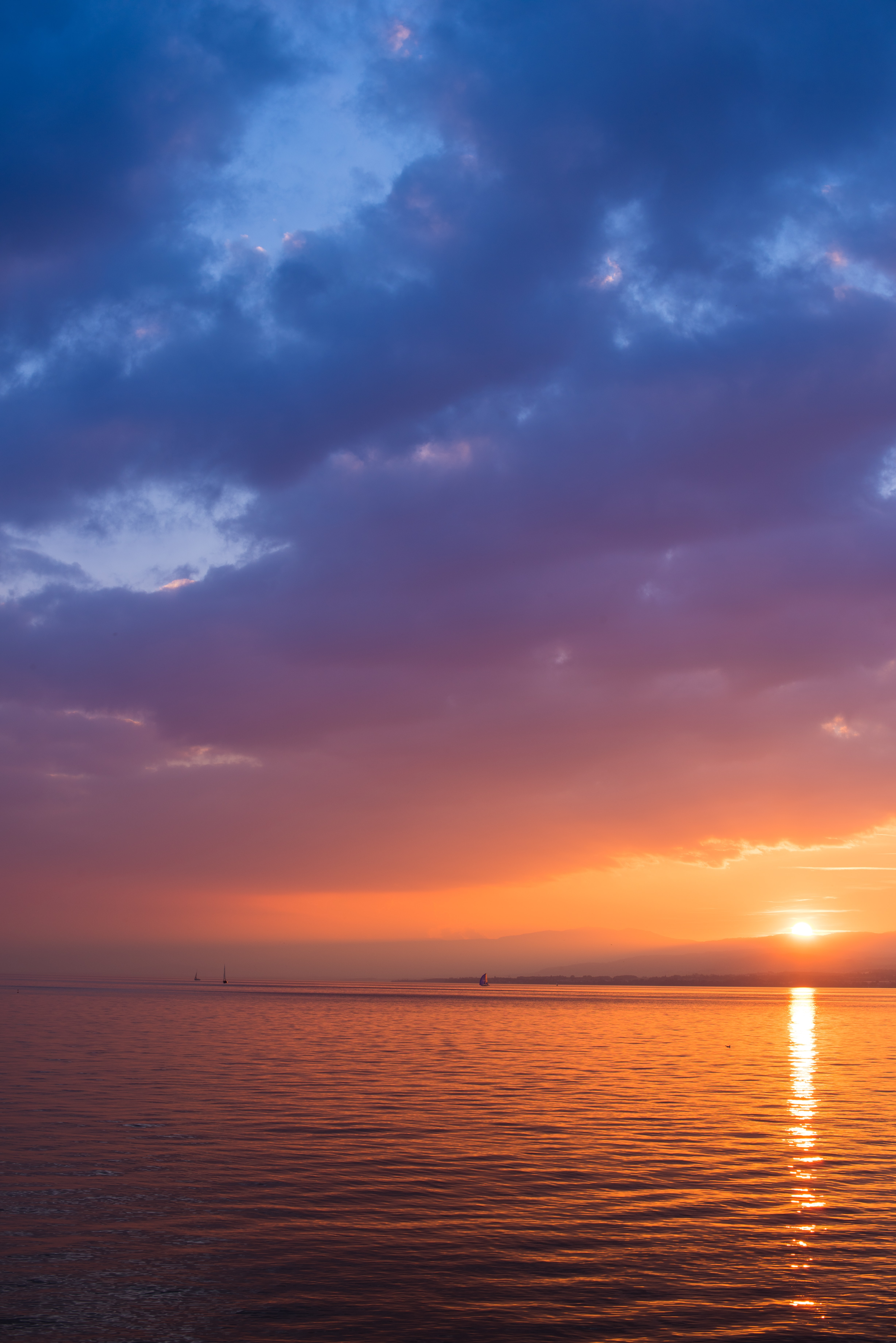 A blue, purple, and orange sunset over the ocean