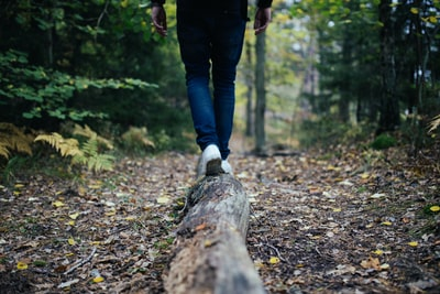 man walking on forest hiking teams background
