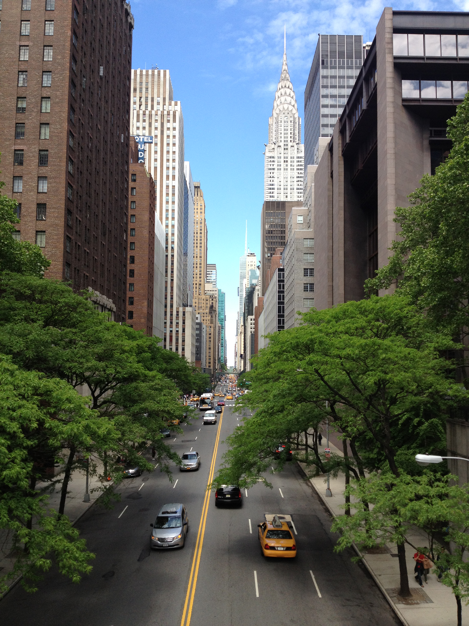 Drone view of a New York City street and cars heading uptown towards the Chrysler Building