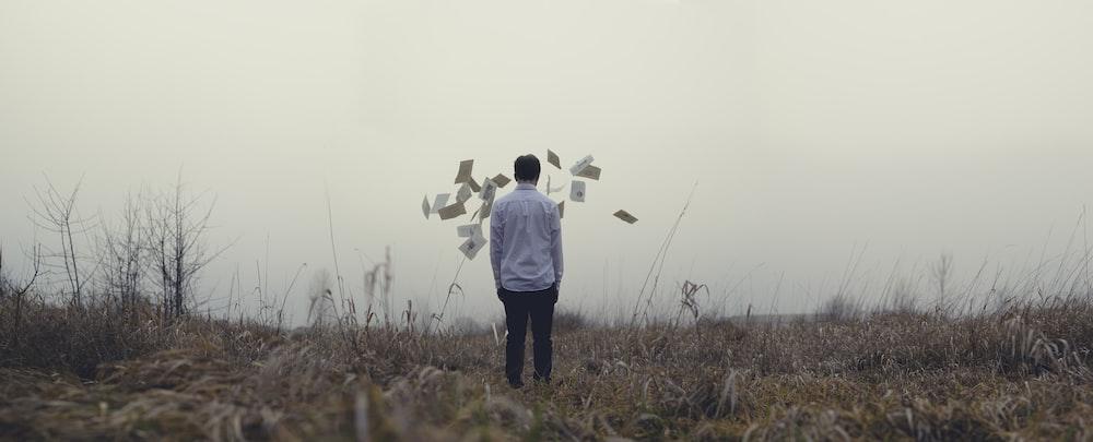 man standing on grass