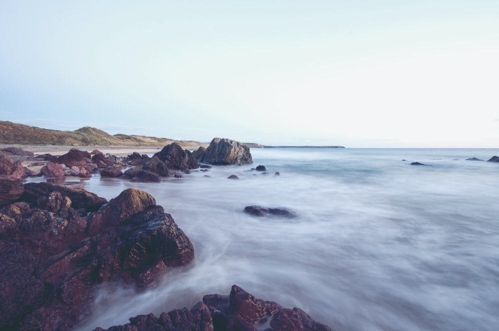 landscape photography of body of water near shore