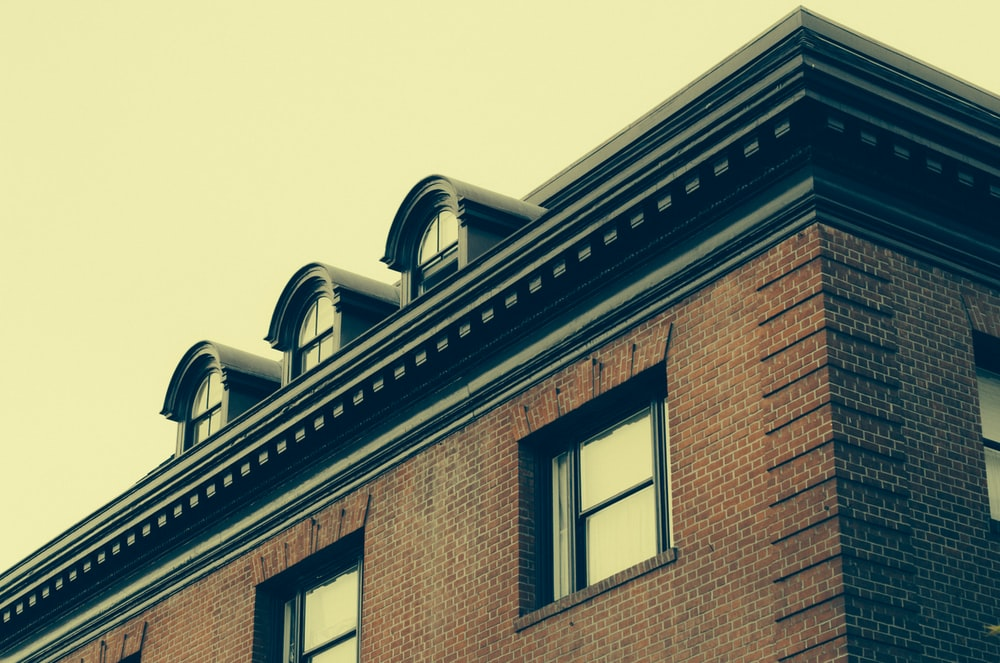 photo of black and brown brick concrete building