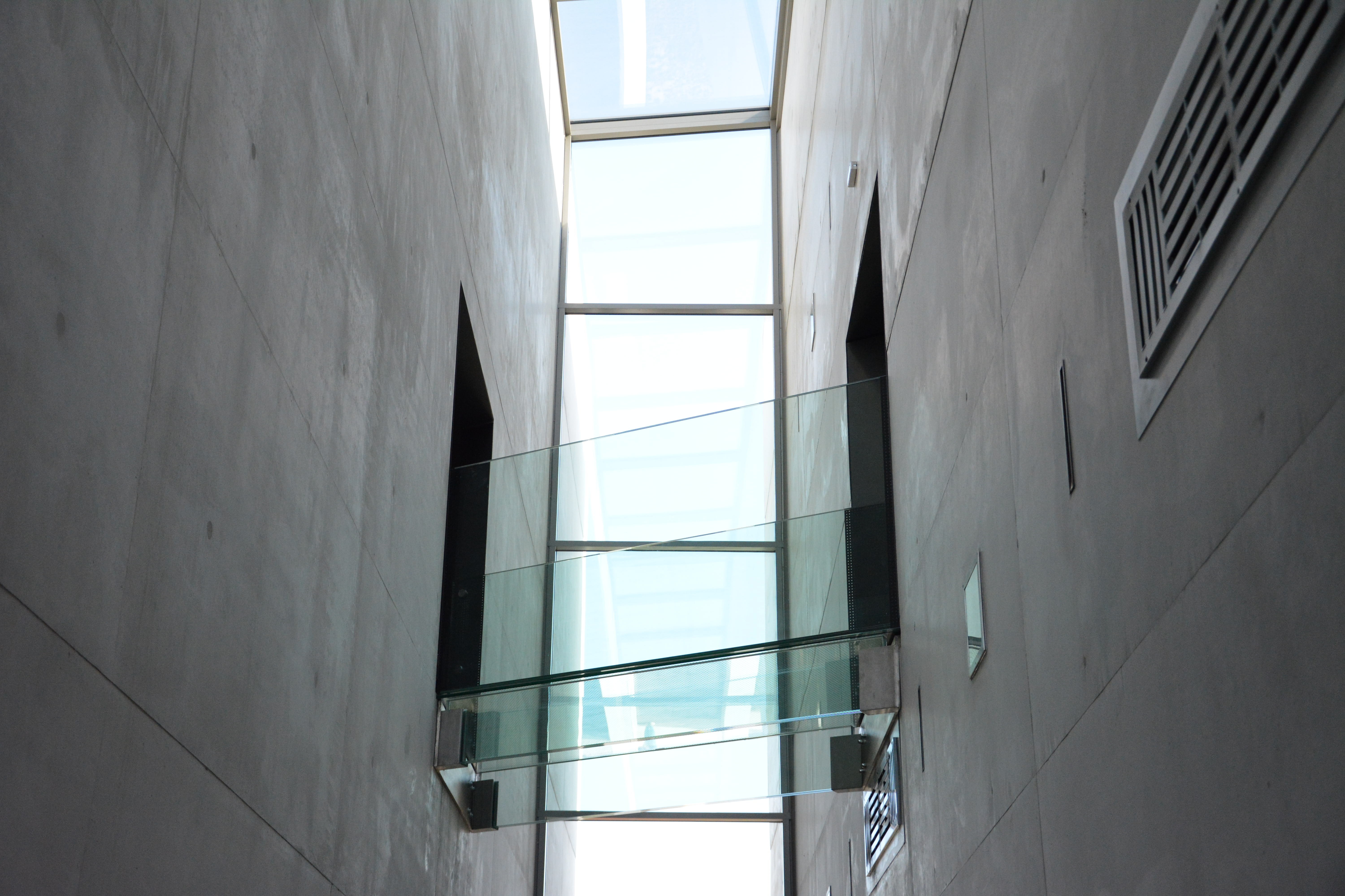 A glass skywalk connecting two parts of a building